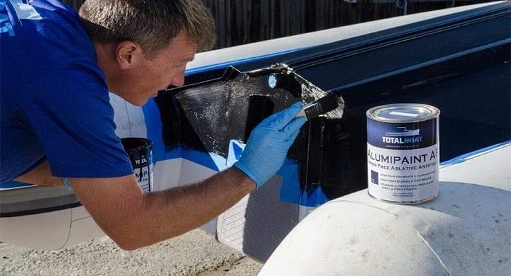 Man Painting Pontoon Boat Bottom