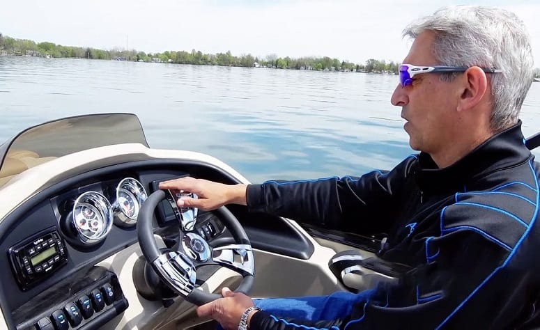 Man Driving A Pontoon Boat